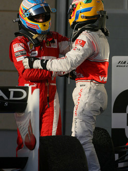 Race winner Fernando Alonso, Scuderia Ferrari celebrates with third place Lewis Hamilton, McLaren Mercedes