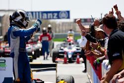 Giacomo Ricci celebrates his victory with his team