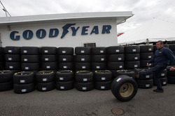 A Goodyear employee kicks a tire to a co-worker