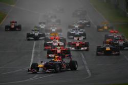 Sebastian Vettel, Red Bull Racing leads the start of the race