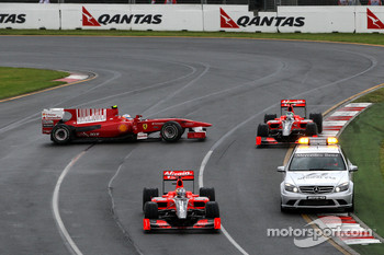 Fernando Alonso, Scuderia Ferrari gets overtaken by the safety car