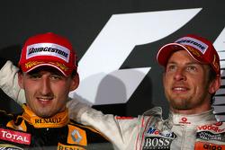 Podium: race winner Jenson Button, McLaren Mercedes, second place Robert Kubica, Renault F1 Team