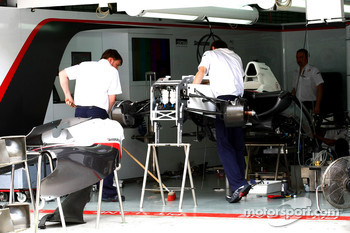 The Sauber team work on thier cars
