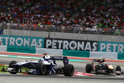 Rubens Barrichello, Williams F1 Team leads Sebastien Buemi, Scuderia Toro Rosso