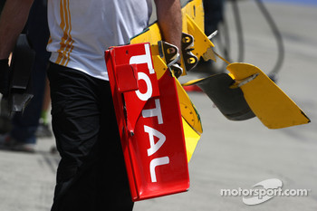 The front wing of Vitaly Petrov, Renault F1 Team is returned to te pits after he crashed
