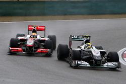 Nico Rosberg, Mercedes GP leads Lewis Hamilton, McLaren Mercedes