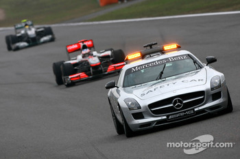 The safety car leads Jenson Button, McLaren Mercedes