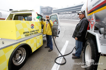Track workers refuel track dryers during a rain delay