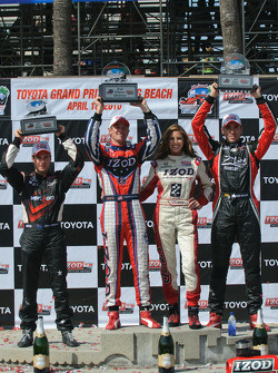 Ryan Hunter-Reay, Will Power and Justin Wilson are joined by Miss Izod on the podium