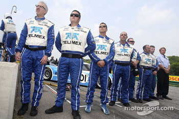 Scott Pruett stands with his crew