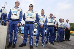 Scott Pruett stands with his crew