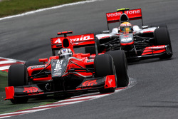 Timo Glock, Virgin Racing leads Lewis Hamilton, McLaren Mercedes
