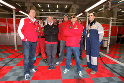Jean Alesi and AF Corse team members watch qualifying