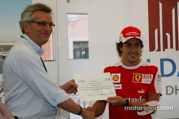 CEO of Aldar Properties presents Fernando Alonso, Scuderia Ferrari with invitations to Yas Marina