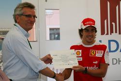 CEO of Aldar Properties presents Fernando Alonso, Scuderia Ferrari with invitations to Yas Marina