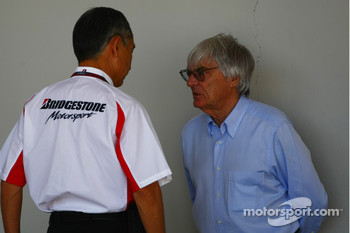 Hiroshi Yasukawa Bridgestone Director of Motorsport with Bernie Ecclestone CEO Formula One Group