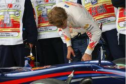Sebastian Vettel, Red Bull Racing looking at his brakes