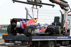 The car of Sebastian Vettel, Red Bull Racing is returned to the pits