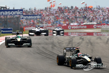 Jarno Trulli, Lotus F1 Team, leads Heikki Kovalainen, Lotus F1 Team