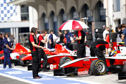 Alexander Rossi, Esteban Gutierrez and Pedro Nunes in the pits