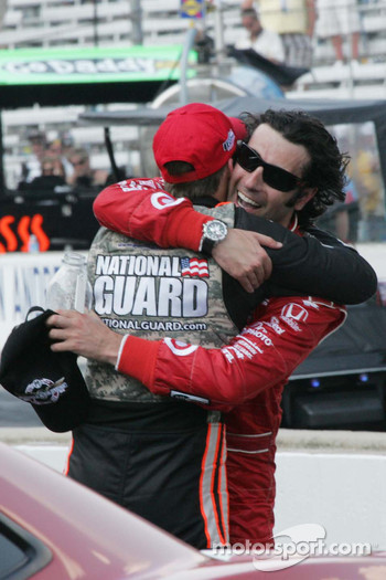 Race winner Dario Franchitti gets a hug from Dan Wheldon
