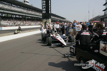 Ryan Briscoe's car, Team Penske, arrives on pit lane