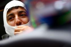 Daniel Ricciardo, Red Bull Racing sits in his car in the garage