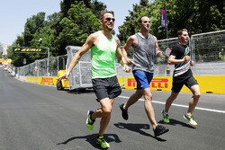 Jenson Button, McLaren, runs the circuit with Stoffel Vandoorne, McLaren Test and Reserve Driver