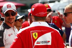 (L to R): Esteban Gutierrez, Haas F1 Team with Kimi Raikkonen, Ferrari and Valtteri Bottas, Williams on the drivers parade