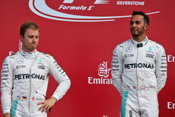 (L to R): Nico Rosberg, Mercedes AMG F1 on the podium with team mate Lewis Hamilton, Mercedes AMG F1