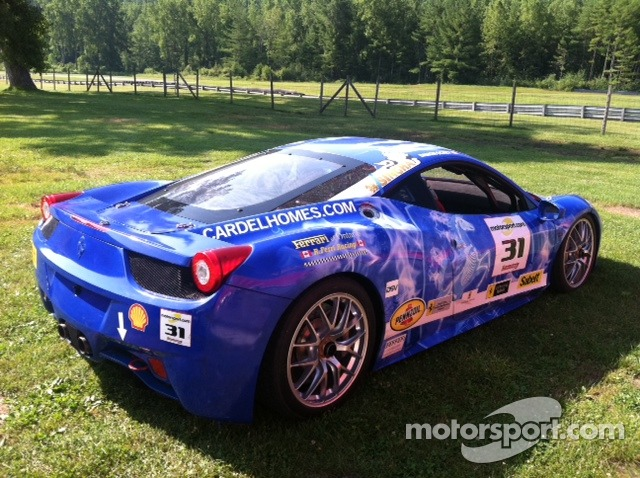 Beautiful blue 458 on the grass at Lime Rock