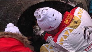 Sébastien Loeb tries to repair his Citroën after crashing at the Rallye Monte Carlo