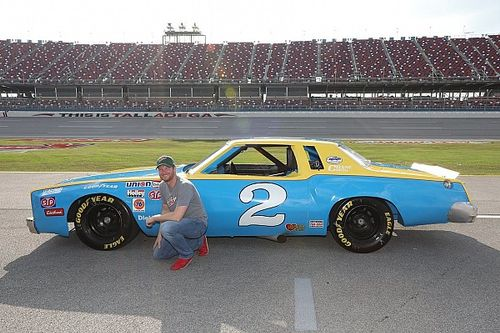 Dale Jr. drives his father's old car around Talladega Superspeedway
