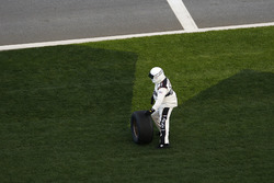 A NASCAR Offical take the tire
