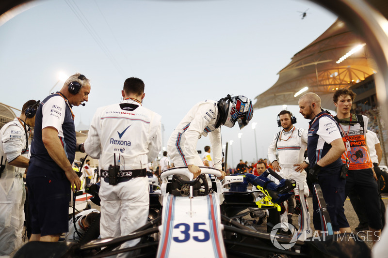 Sergey Sirotkin, Williams FW41 Mercedes, climbs from his car on the grid