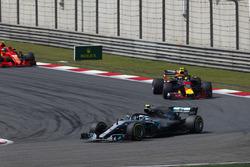 Valtteri Bottas, Mercedes AMG F1 W09, leads Max Verstappen, Red Bull Racing RB14 Tag Heuer, and Kimi Raikkonen, Ferrari SF71H