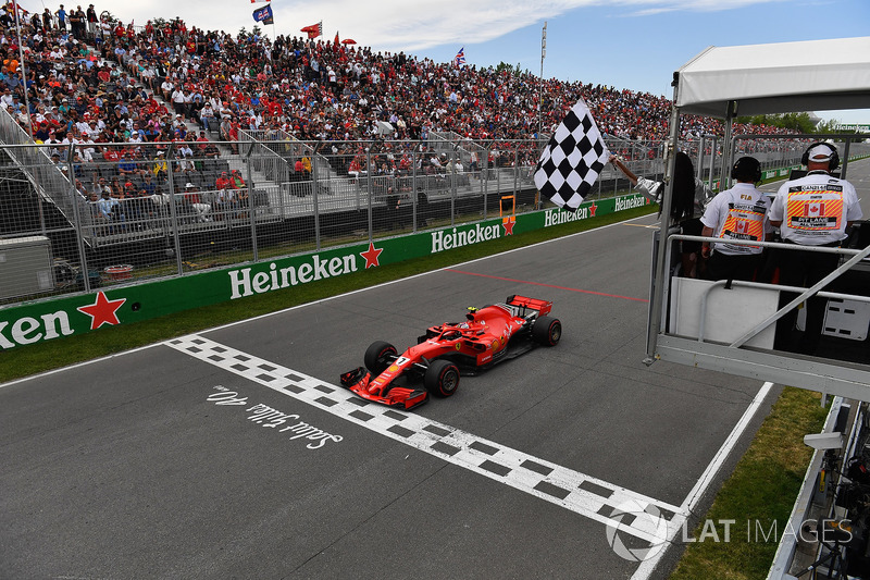 Kimi Raikkonen, Ferrari SF71H takes the chequered flag waved by Winnnie Harlow (CDN)
