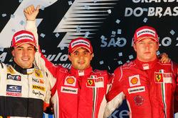 Podium: race winner Felipe Massa, Ferrari, second place Fernando Alonso, Renault and third place Kimi Raikkonen, Ferrari
