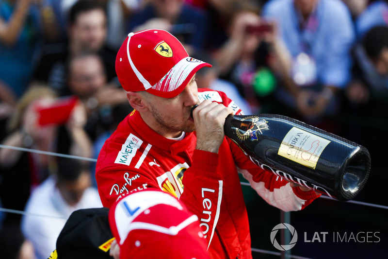 Race winner Sebastian Vettel, Ferrari, drinks Champagne on the podium