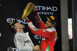 Second place Nico Rosberg, Mercedes AMG F1 celebrates his World Championship on the podium with Seba