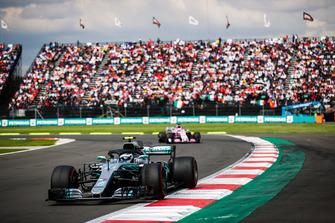 Valtteri Bottas, Mercedes AMG F1 W09 EQ Power+, leads Sergio Perez, Racing Point Force India VJM11