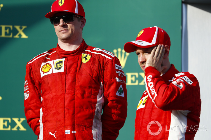 Kimi Raikkonen, Ferrari, and Sebastian Vettel, Ferrari, celebrate on the podium