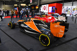 A McLaren and Ferrari on the F1 Racing Stand