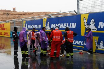 Marshals attempt to dry the track