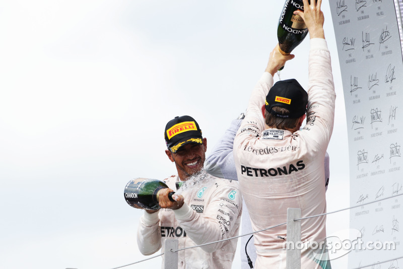 Race winner Lewis Hamilton, Mercedes AMG F1 celebrates on the podium with team mate Nico Rosberg Mercedes AMG F1