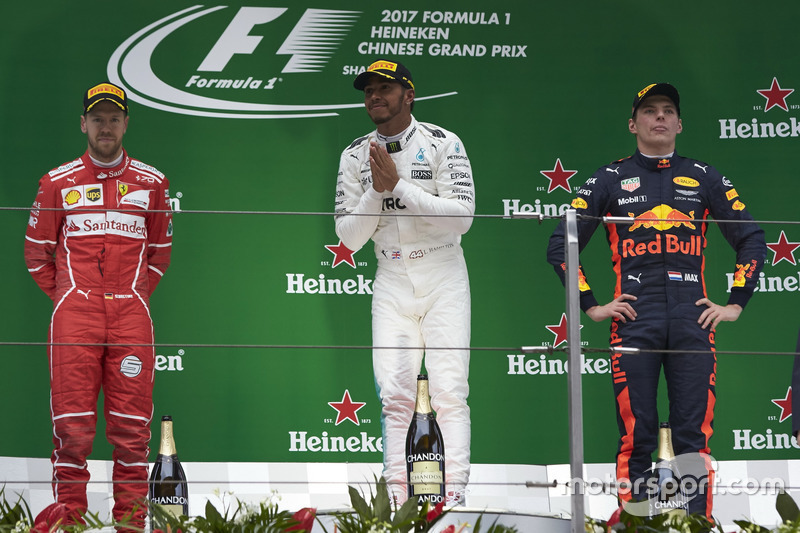 Podium: second place Sebastian Vettel, Ferrari, race winner Lewis Hamilton, Mercedes AMG, third place Max Verstappen, Red Bull Racing