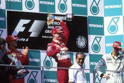 Podium: Race winner Eddie Irvine, Ferrari, second place Michael Schumacher, third place Mika Hakkinen, McLaren