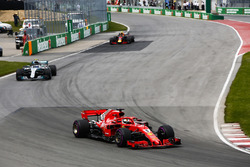 Sebastian Vettel, Ferrari SF71H, leads Valtteri Bottas, Mercedes AMG F1 W09, and Max Verstappen, Red Bull Racing RB14