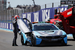 Nelson Piquet Jr., Jaguar Racing, climbs into the BMW i8 safety car after a crash