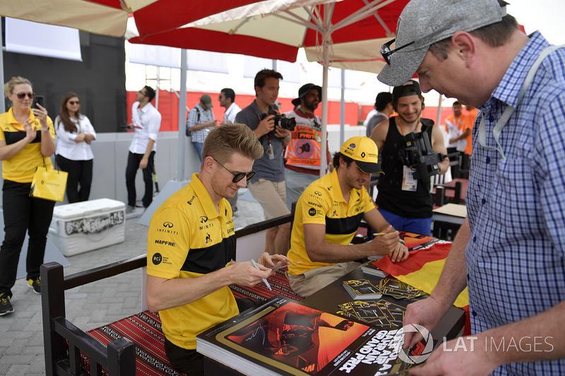 Nico Hulkenberg, Renault Sport F1 Team and Carlos Sainz Jr., Renault Sport F1 Team at the autograph